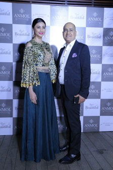 Daisy Shah with Ishu Datwani, founder, ANMOL at ANMOL's campaign launch event