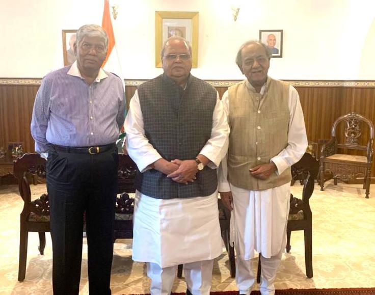 H.E. Mr. Satya Pal Malik, Hon'ble Governor of Goa, Mr. Kamal Morarka, and Mr. Vijay Kalantri.jpg